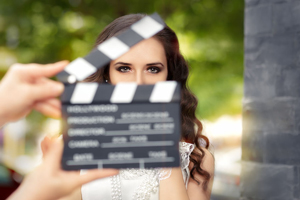 Blurred clapperboard and woman during filming