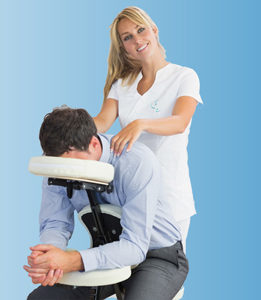 Man in office shirt receiving an on site chair massage from a Sense therapist