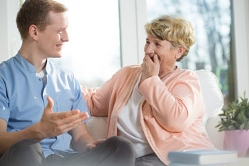 Young man and older woman chatting